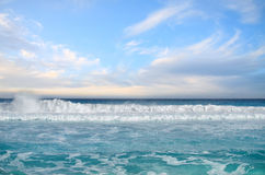 White foamy waves and gradually darkening color of sea Stock Photo