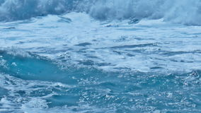 White Foamy Waves Splashing over Turquoise Sea. Static medium long close up shallow depth of field shot of white foamy waves rolling and splashing over turquoise stock video footage