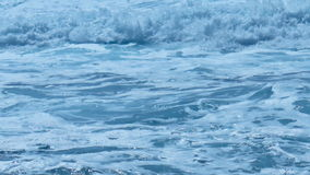 White Foamy Waves on Turquoise Sea. Static medium long close up shallow depth of field shot of white foamy waves rolling over turquoise fresh azure sea water stock footage