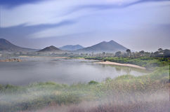 White fog over the river in the morning. White fog over the river and mountain in the early morning Stock Photo