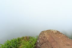 White fog. Rock with white fog in background Royalty Free Stock Photos