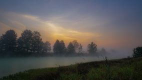White fog is spreading over the river stock photography