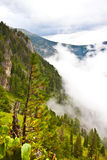 White fog on valley between two mountain peaks Royalty Free Stock Photo