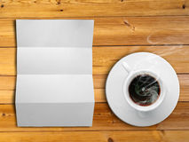 White fold paper and a white coffee cup Stock Images