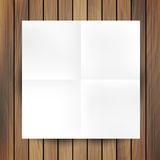 White folded paper mockup card isolated on wood Royalty Free Stock Photos