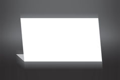White folded paper standing on grey background royalty free stock photo