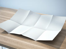 White folded sheet of paper. On table Stock Images