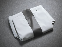 White folded t-shirt with blank label Stock Photo