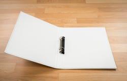 White  folder on wood Stock Image