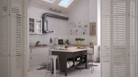 White folding door opening on contemporary kitchen in scandinavian style, interior design, architect designer concept. Blur background royalty free stock photography