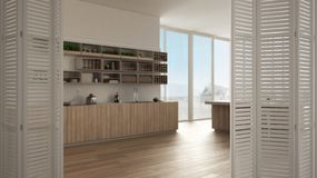 White folding door opening on minimalist kitchen with cabinets and island, open space with panoramic window, architect designer co. Ncept, blur background royalty free stock image