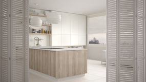 White folding door opening on modern luxury contemporary minimalistic white and wooden kitchen, interior design. Architect designer concept, blur background royalty free stock photography