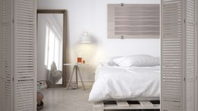 White folding door opening on modern minimalist bedroom with double bed, interior design, architect designer concept. Blur background royalty free stock images
