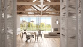 White folding door opening on modern open space living room and kitchen, white interior design, architect designer concept, blur. Background royalty free stock image