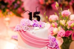 White Fondant Cake With 15 Candles on Top Royalty Free Stock Images