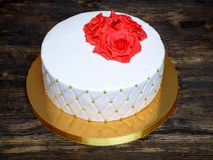 White fondant cake with red cream sugar flowers Stock Photos