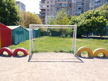 White football goals on the playground with sand Royalty Free Stock Photo