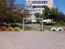 White football goals on the playground with sand Royalty Free Stock Photography