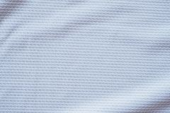 White football jersey clothing fabric texture sports wear backgr. Ound, close up Stock Image