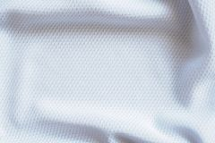 White football jersey clothing fabric texture sports wear. Background, close up Stock Photos