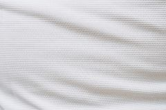 White football jersey clothing fabric texture sports wear. Background, close up Stock Photo