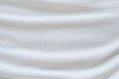 White football jersey clothing fabric texture sports wear. Background, close up Royalty Free Stock Photography