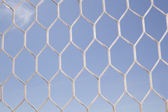 White football, soccer net and blue sky Royalty Free Stock Photo