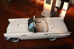White Ford Thunderbird 1957 in an in an exhibition hall. White Ford Thunderbird 1957 in an exhibition hall with wooden floor Stock Photo