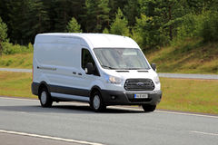White Ford Transit Van on Motorway. PAIMIO, FINLAND - JULY 8, 2017: White Ford Transit van moves along motorway at speed in summer Royalty Free Stock Photos