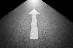 White forward arrow sign on grey asphalt road Stock Photography