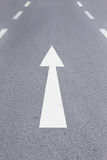 White forward arrow on the street Royalty Free Stock Image