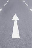 White forward arrow on the street Royalty Free Stock Image
