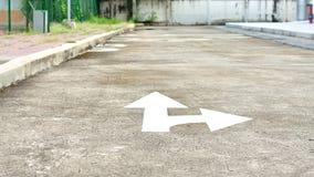White forward and right directional arrow on asphalt Stock Photo
