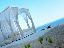 White four-poster bed standing outdoors with seascape view Royalty Free Stock Photography