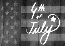 White fourth of July graphic against grey american flag on wood panel. Digital composite of White fourth of July graphic against grey american flag on wood panel Royalty Free Stock Photo