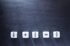 White fraction mah number dices showing simple equation on black Stock Photos