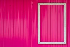 White frame on the bright pink wall. royalty free stock photo