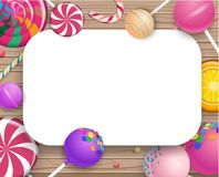 White frame with colorful lollipops on wooden background. White frame with bright colorful 3d lollipops on wooden textured background. Vector illustration.r Royalty Free Stock Photography