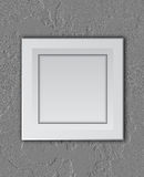 White frame on concrete wall Royalty Free Stock Image