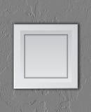 White frame on concrete wall Royalty Free Stock Image