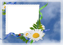 White frame with flowers on the blue background. White frame with bouquet of flowers on the blue background Royalty Free Stock Image