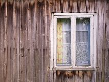 White frame in a gray wall. Old window in the wooden wall. Could be used as a background Royalty Free Stock Photography