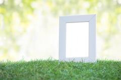 White frame on green grass Stock Photo