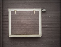 White frame on the grunge wooden plank wall Stock Photos