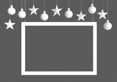 White frame with hanging  balls and stars ornaments on dark background. For new year or christmas theme. 3D rendering. Stock Photography