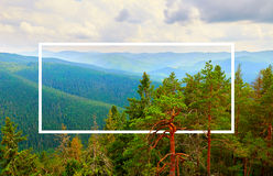 White frame, integrated in the landscape, for your content. Fairy Tale Forest, Mountain Landscape Stock Photo