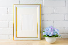 White frame mockup with blue hydrangea Royalty Free Stock Images