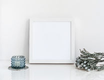 White frame mockup with brunia and candle. Royalty Free Stock Photos