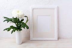 White frame mockup with chrysanthemum in vase Royalty Free Stock Photo