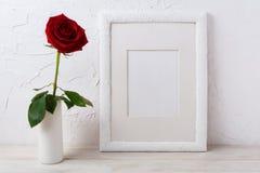 White frame mockup with dark red rose in vase Stock Photo